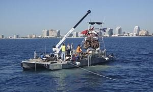 A salvage crew hauls up tyres from Osborne Tyre Reef off the coast of Fort Lauderdale, Florida