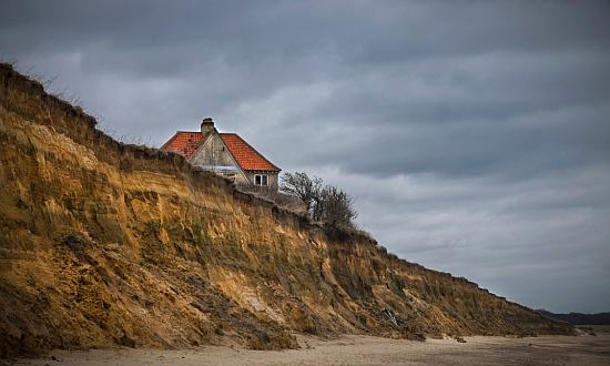 A house on the edge of the cliffs at Easton Bavents, Southwold, Suffolk.