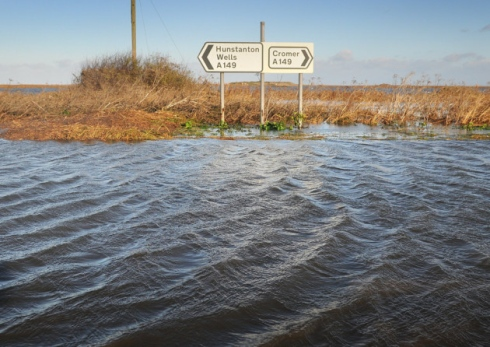 Flood damage. The A149 through Salthouse totally covered with sea water.