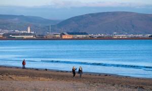 Walkers near Swansea Bay