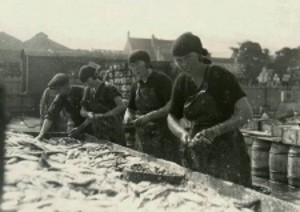 Gutting herring at Denmark Road, Lowestoft, in the 1920s