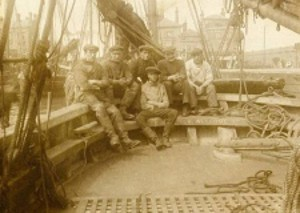 The crew of the smack Welcome in Lowestoft trawl basin, in about 1905
